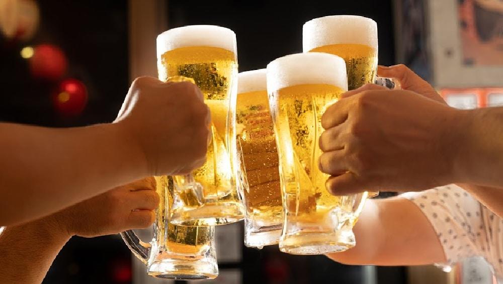 friends with beers having fun