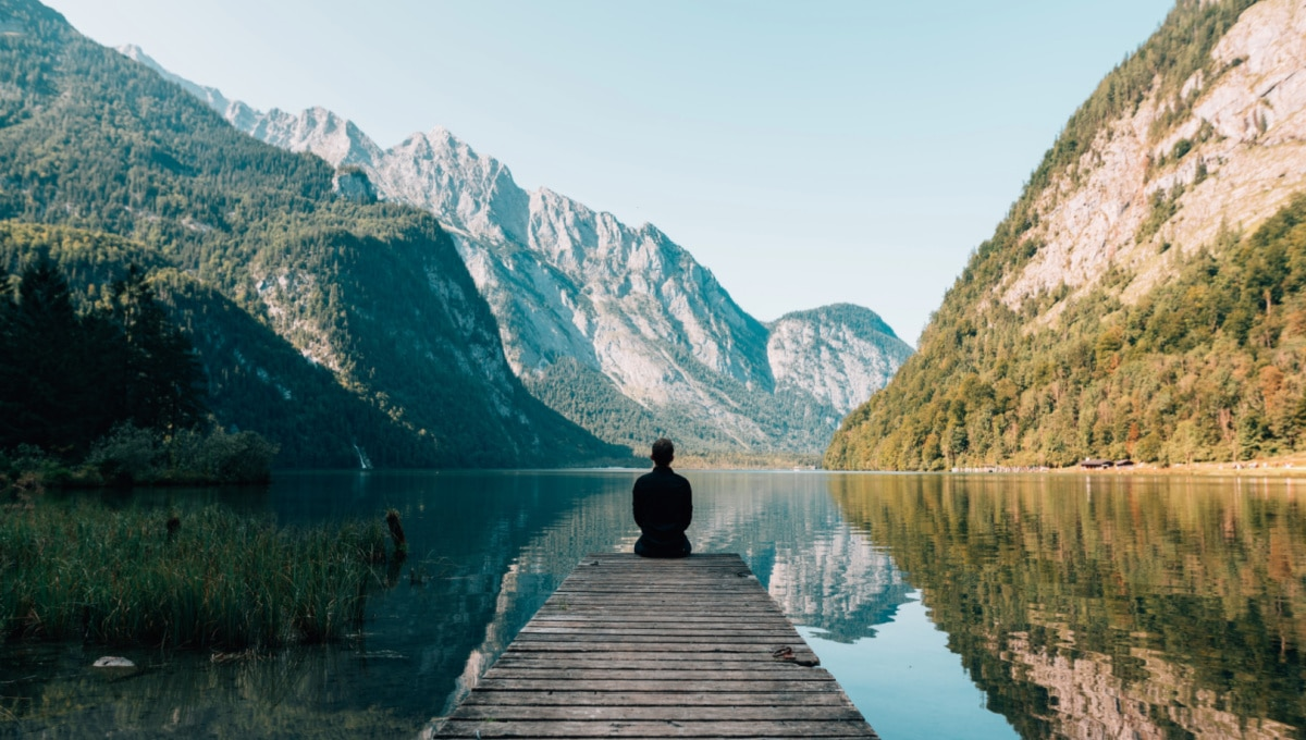 mastering mindfulness sitting by the lake on a dock